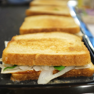 BBQ-Style Grilled Cheese with Caramelized Onions and Basil